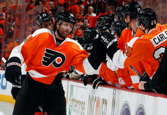 PHILADELPHIA, PA - APRIL 22:  Scott Hartnell #19 of the Philadelphia Flyers celebrates his goal with teammates at the bench in the first period of Game Six of the Eastern Conference Quarterfinals against the Pittsburgh Penguins during the 2012 NHL Stanley