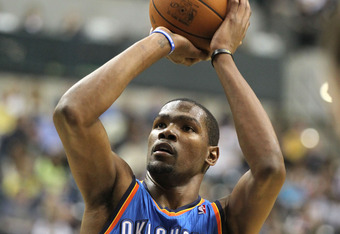 INDIANAPOLIS, IN - APRIL 06:  Kevin Durant #35 of the Oklahoma City Thunder dunks the ball during the NBA game against the Indiana Pacers at Bankers Life Fieldhouse on April 6, 2012 in Indianapolis, Indiana.  NOTE TO USER: User expressly acknowledges and