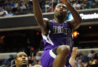 WASHINGTON, DC - FEBRUARY 22:  Tyreke Evans #13 of the Sacramento Kings puts up a shot in front of Trevor Booker #35 of the Washington Wizards during the first half at Verizon Center on February 22, 2012 in Washington, DC. NOTE TO USER: User expressly ack
