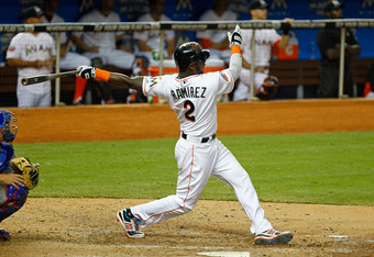 MIAMI, FL - APRIL 17: Hanley Ramirez #2 of the Miami Marlins hits a two-run home run during a game against the Chicago Cubs at Marlins Park on April 17, 2012 in Miami, Florida.  (Photo by Mike Ehrmann/Getty Images)