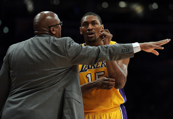 LOS ANGELES, CA - APRIL 06:  Metta World Peace #15 of the Los Angeles Lakers speaks to Head Coach Mike Brown during the game against the Houston Rockets at Staples Center on April 6, 2012 in Los Angeles, California.  NOTE TO USER: User expressly acknowled