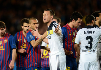BARCELONA, SPAIN - APRIL 24: John Terry (C) of Chelsea reacts after receiving a direct red card during the UEFA Champions League Semi Final second leg match between FC Barcelona and Chelsea FC at the Camp Nou stadium on April 24, 2012 in Barcelona, Spain.