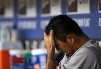 ARLINGTON, TX - APRIL 24:  Hiroki Kuroda #18 of the New York Yankees sits in the dugout after leaving the game against the Texas Rangers in the first inning at Rangers Ballpark in Arlington on April 24, 2012 in Arlington, Texas.  (Photo by Ronald Martinez