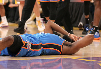LOS ANGELES, CA - APRIL 22:  James Harden #13 of the Oklahoma City Thunder lies on the floor after being elbowed by Metta World Peace #15 of the Los Angeles Lakers  at Staples Center on April 22, 2012 in Los Angeles, California.  NOTE TO USER: User expres
