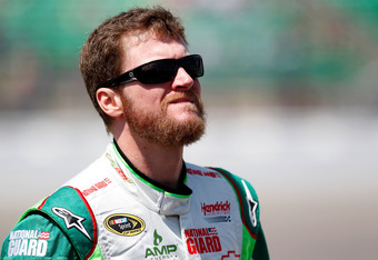KANSAS CITY, KS - APRIL 21:  Dale Earnhardt Jr., driver of the #88 Diet Mountain Dew/National Guard Chevrolet, looks on during qualifying for the NASCAR Sprint Cup Series STP 400 at Kansas Speedway on April 21, 2012 in Kansas City, Kansas.  (Photo by Geof