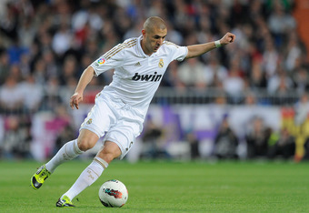 MADRID, SPAIN - APRIL 08: Karim Benzema of Real Madrid CF in action during the La Liga match between Real Madrid CF and Valencia CF at Estadio Santiago Bernabeu on April 8, 2012 in Madrid, Spain.  (Photo by Denis Doyle/Getty Images)