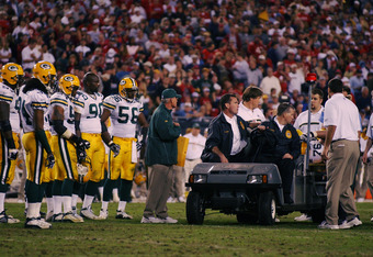 TAMPA - NOVEMBER 24:  Chad Clifton #76 of the Green Bay Packers is taken off the field after injuring his pelvis on a play during the game against the Tampa Bay Buccaneers on November 24, 2002 at Raymond James Stadium in Tampa, Florida. The Buccs beat the