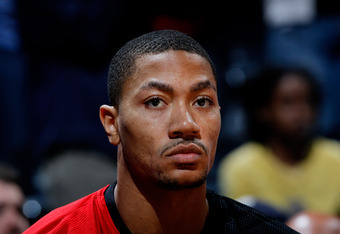 ATLANTA, GA - MARCH 28:  Derrick Rose #1 of the Chicago Bulls looks on from the bench against the Atlanta Hawks at Philips Arena on March 28, 2012 in Atlanta, Georgia.  NOTE TO USER: User expressly acknowledges and agrees that, by downloading and or using