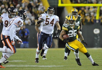 GREEN BAY, WI - DECEMBER 25:  Ryan Grant #25 of the Green Bay Packers is pursued by  Brian Urlacher #54 and  Major Wright #27 of the Chicago Bears on December 25, 2011 at Lambeau Field in Green Bay, Wisconsin.  (Photo by David Banks/Getty Images)