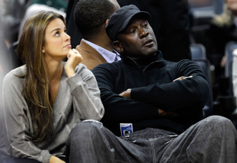 CHARLOTTE, NC - FEBRUARY 10:  Charlotte Bobcats owner, Michael Jordan sits beside fiance, Yvette Prieto during the game between the Chicago Bulls and the Charlotte Bobcats at Time Warner Cable Arena on February 10, 2012 in Charlotte, North Carolina. NOTE