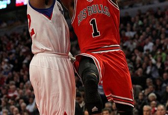 CHICAGO, IL - MARCH 28: Derrick Rose #1 of the Chicago Bulls puts up a shot against Elton Brand #42 of the Philadelphia 76ers on his way to a game-high 31 points at the United Center on March 28, 2011 in Chicago, Illinois. The 76ers defeated the Bulls 97-