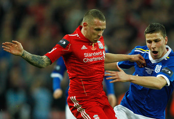 LONDON, ENGLAND - FEBRUARY 26:  Craig Bellamy of Liverpool battles with Filip Kiss of Cardiff City during the Carling Cup Final match between Liverpool and Cardiff City at Wembley Stadium on February 26, 2012 in London, England.  (Photo by Paul Gilham/Get