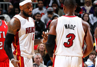 ATLANTA, GA - FEBRUARY 12:  LeBron James #6 and Dwyane Wade #3 of the Miami Heat converse after a miscommunication on defense against the Atlanta Hawks at Philips Arena on February 12, 2012 in Atlanta, Georgia.  NOTE TO USER: User expressly acknowledges a