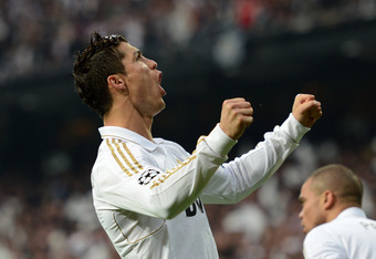 MADRID, SPAIN - APRIL 25:  Cristiano Ronaldo of Real Madrid celebrates scoring from the penalty spot  during the UEFA Champions League Semi Final second leg between Real Madrid CF and Bayern Munich at The Bernabeu Stadium on April 25, 2012 in Madrid, Spai