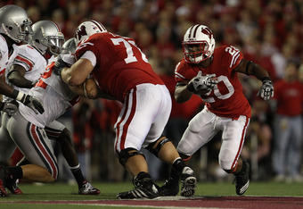 MADISON, WI - OCTOBER 16: James White #20 of the Wisconsin Badgers runs past blocker Kevin Zeitler #70 against the Ohio State Buckeyes at Camp Randall Stadium on October 16, 2010 in Madison, Wisconsin. Wisconsin defeated Ohio State 31-18.  (Photo by Jonat