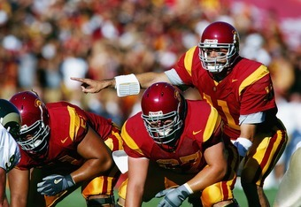 LOS ANGELES - SEPTEMBER 11:  Quarterback Matt Leinart #11 calls an audible before the snap from center Ryan Kalil #67 of the USC Trojans during the game with the Colorado State Rams on September 11, 2004 at the Coliseum in Los Angeles, California. The Tro