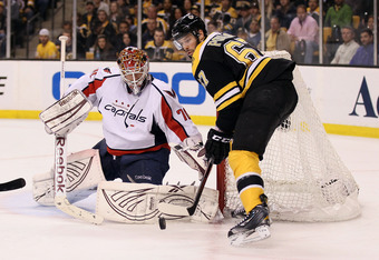 BOSTON, MA - APRIL 25:  Braden Holtby #70 of the Washington Capitals stops a shot by Benoit Pouliot #67 of the Boston Bruins in Game Seven of the Eastern Conference Quarterfinals during the 2012 NHL Stanley Cup Playoffs at TD Garden on April 25, 2012 in B