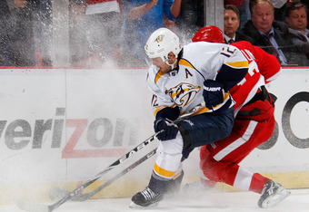 DETROIT, MI - APRIL 17: Mike Fisher #12 of the Nashville Predators battles for the puck with Pavel Datsyuk #13 of the Detroit Red Wings during Game Four of the Western Conference Quarterfinals during the 2012 NHL Stanley Cup Playoffs at Joe Louis Arena on