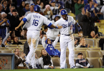 LOS ANGELES, CA - APRIL 23:  Matt Kemp #27 of the Los Angeles Dodgers and Andre Ethier #16 celebrate after scoring on a two-run single by Juan Uribe #5 during the eighth inning against the Atlanta Braves at Dodger Stadium on April 23, 2012 in Los Angeles,