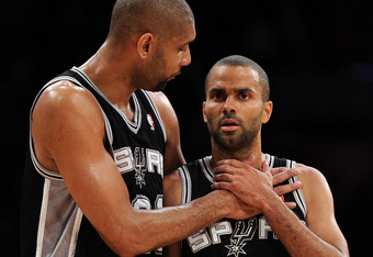 LOS ANGELES, CA - APRIL 17:  Tim Duncan #21 and Tony Parker #9 of the San Antonio Spurs talk during a break in the game against the Los Angeles Lakers at Staples Center on April 17, 2012 in Los Angeles, California.  NOTE TO USER: User expressly acknowledg