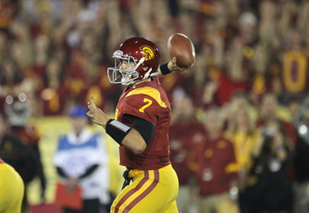 LOS ANGELES, CA - NOVEMBER 26:  Quarterback Matt Barkley #7 of the USC Trojans throws a pass against the UCLA Bruins at the Los Angeles Memorial Coliseum on November 26, 2011 in Los Angeles, California.  (Photo by Stephen Dunn/Getty Images)
