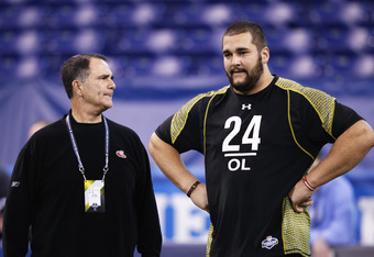 INDIANAPOLIS, IN - FEBRUARY 25: Offensive lineman Matt Kalil of USC talks with San Francisco 49ers offensive line coach Mike Solari during the 2012 NFL Combine at Lucas Oil Stadium on February 25, 2012 in Indianapolis, Indiana. (Photo by Joe Robbins/Getty