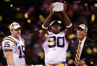 NEW ORLEANS - JANUARY 07:  Ricky Jean-Francois #90 of the Louisiana State University Tigers celebrates with the championship trophy after defeating the Ohio State Buckeyes 38-24 in the AllState BCS National Championship on January 7, 2008 at the Louisiana