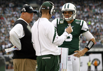 EAST RUTHERFORD, NJ - NOVEMBER 27:  New York Jets offensive coordinator  Brian Schottenheimer and head coach Rex Ryan (L) talk with Mark Sanchez #6 of the New York Jets during their game against the Buffalo Bills at MetLife Stadium on November 27, 2011 in