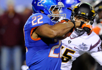 LAS VEGAS, NV - DECEMBER 22:  Doug Martin #22 of the Boise State Broncos returns the opening kickoff for a touchdown against the Arizona State Sun Devils during the MAACO Bowl Las Vegas at Sam Boyd Stadium December 22, 2011 in Las Vegas, Nevada.  (Photo b