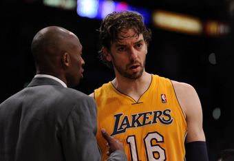 LOS ANGELES, CA - APRIL 17:  Pau Gasol #16 of the Los Angeles Lakers talks with Kobe Bryant #24 during a 112-91 loss to the San Antonio Spurs at Staples Center on April 17, 2012 in Los Angeles, California.  NOTE TO USER: User expressly acknowledges and ag