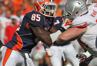 CHAMPAIGN, IL - OCTOBER 15:  Whitney Mercilus #85 of the Illinois Fighting Illini rushes against Jack Mewhort #74 of the Ohio State Buckeyes at Memorial Stadium on October 15, 2011 in Champaign, Illinois. Ohio State defeated Illinois 17-7.  (Photo by Jona