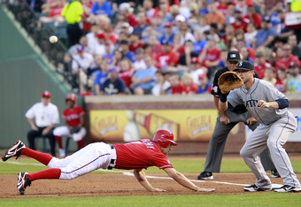 ARLINGTON, TX - APRIL 10: David Murphy #7 of the Texas Rangers dives back to first beating the tag by Justin Smoak #17 of the Seattle Mariners at Rangers Ballpark in Arlington on April 10, 2012 in Arlington, Texas. (Photo by Rick Yeatts/Getty Images)