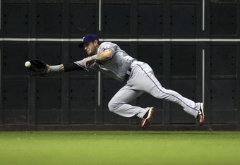 HOUSTON - JUNE 30:  Left fielder Josh Hamilton #32 of the Texas Rangers makes a diving catch on a line drive hit by Chris Johnson of the Houston Astros in the seventh inning at Minute Maid Park on June 30, 2011 in Houston, Texas. Houston won 7-0.  (Photo