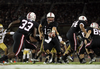 STANFORD, CA - OCTOBER 01:  Andrew Luck #12 of the Stanford Cardinal hands the ball off to Stepfan Taylor #33 of the Stanford Cardinal during their game against the UCLA Bruins at Stanford Stadium on October 1, 2011 in Stanford, California.  (Photo by Ezr