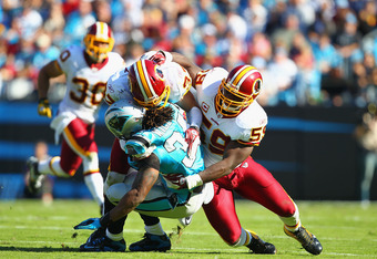 CHARLOTTE, NC - OCTOBER 23: London Fletcher #59 and Reed Doughty #37 both of the Washington Redskins make tackle against the Carolina Panthers at the Bank of America Stadium on October 23, 2011 in Charlotte, North Carolina.  (Photo by Dilip Vishwanat/Gett