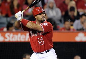 ANAHEIM, CA - APRIL 19:  Albert Pujols #5 of the Los Angeles Angels at bat against the Oakland Athletics at Angel Stadium of Anaheim on April 19, 2012 in Anaheim, California.  (Photo by Harry How/Getty Images)