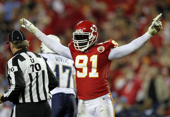 KANSAS CITY, MO - OCTOBER 31:  Tamba Hali #91 of the Kansas City Chiefs celebrates after sacking quarterback Philip Rivers #17 of the San Diego Chargers during the game on October 31, 2011 at Arrowhead Stadium in Kansas City, Missouri.  (Photo by Jamie Sq