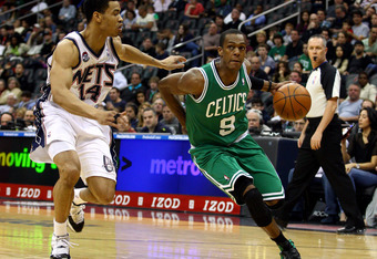 NEWARK, NJ - APRIL 14:  Rajon Rondo #9 of the Boston Celtics drives in the first half against Gerald Green #14 of the New Jersey Nets at Prudential Center on April 14, 2012 in Newark, New Jersey. NOTE TO USER: User expressly acknowledges and agrees that,