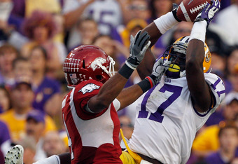 BATON ROUGE, LA - NOVEMBER 25:  Morris Claiborne #17 of the Louisiana State University Tigers catches an interception intended for Jarius Wright #4 of the Arkansas Razorbacks at Tiger Stadium on November 25, 2011 in Baton Rouge, Louisiana.  (Photo by Chri