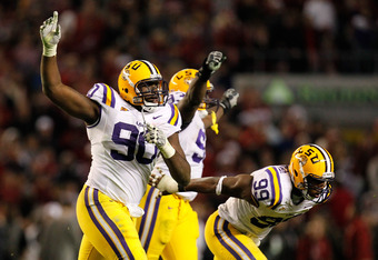 TUSCALOOSA, AL - NOVEMBER 05:  Michael Brockers #90 and Sam Montgomery #99 of the LSU Tigers react after the Alabama Crimson Tide missed their field goal in overtime at Bryant-Denny Stadium on November 5, 2011 in Tuscaloosa, Alabama.  (Photo by Kevin C. C