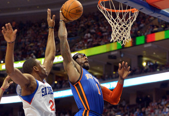 PHILADELPHIA, PA - MARCH 21: Amare Stoudemire #1 of the New York Knicks dunks on Thaddeus Young #21 of the Philadelphia 76ers at the Wells Fargo Center on March 21, 2012 in Philadelphia, Pennsylvania. NOTE TO USER: User expressly acknowledges and agrees t