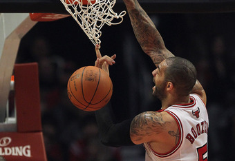 CHICAGO, IL - APRIL 26:  Carlos Boozer #5 of the Chicago Bulls dunks over Antawn Janison #4 of the Cleveland Cavaliers at the United Center on April 26, 2012 in Chicago, Illinois. NOTE TO USER: User expressly acknowledges and agrees that, by downloading a