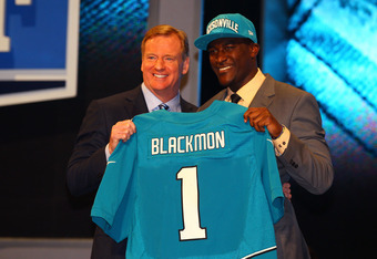 NEW YORK, NY - APRIL 26:  Justin Blackmon (R) from Oklahoma State holds up a jersey as he stands on stage with NFL Commissioner Roger Goodell after he was selected #5 overall by the Jacksonville Jaguars in the first round of the 2012 NFL Draft at Radio Ci