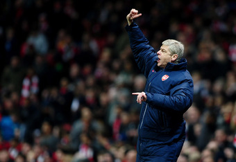 LONDON, ENGLAND - MARCH 06:  Manager of Arsenal, Arsene Wenger shouts instructions during the UEFA Champions League Round of 16 second leg match between Arsenal and AC Milan at Emirates Stadium on March 6, 2012 in London, England.  (Photo by Laurence Grif