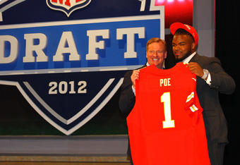 NEW YORK, NY - APRIL 26:  Dontari Poe of Memphis holds up a jersey as he stands on stage with NFL Commissioner Roger Goodell after he was selected #11 overall by the Kansas City Chiefs in the first round of the 2012 NFL Draft at Radio City Music Hall on A
