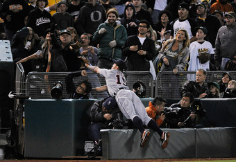 OAKLAND, CA - SEPTEMBER 16: Brandon Inge #15 of the Detroit Tigers dives into the photographers box after a foul ball off the bat of Cliff Pennington #2 of the Oakland Athletics in the seventh inning during an MLB baseball game at O.co Coliseum on Septemb
