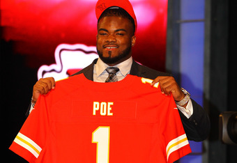 NEW YORK, NY - APRIL 26:  Dontari Poe of Memphis holds up a jersey as he stands on stage after he was selected #11 overall by the Kansas City Chiefs in the first round of the 2012 NFL Draft at Radio City Music Hall on April 26, 2012 in New York City.  (Ph