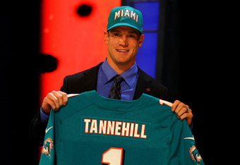 NEW YORK, NY - APRIL 26:  Ryan Tannehill from Texas A&M holds up a jersey as he stands on stage after he was selected #8 overall by the Miami Dolphins in the first round of during the 2012 NFL Draft at Radio City Music Hall on April 26, 2012 in New York C