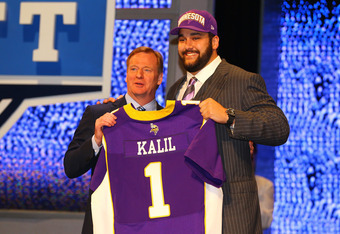 NEW YORK, NY - APRIL 26:  Matt Kalil (R) from USC holds up a jersey as he stands on stage with NFL Commissioner Roger Goodell after he was selected #4 overall by the Minnesota Vikings in the first round of the 2012 NFL Draft at Radio City Music Hall on Ap