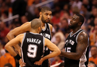 PHOENIX, AZ - MARCH 27:  Tim Duncan #21, DeJuan Blair #45 and 	Tony Parker #9 of the San Antonio Spurs talk during the NBA game against the Phoenix Suns at US Airways Center on March 27, 2012 in Phoenix, Arizona. The Spurs defeated the Suns 107-100. NOTE